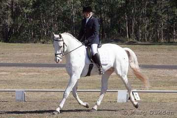 Cayuse A Grand Illusion & Samantha McAuliffe competing in the Open Preliminary Dressage.