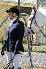 Samantha McAuliffe vocalises some encouragement to another dressage competitor, Cayuse A Grand Illusion catches a little shut-eye in the morning sun.