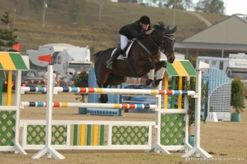 """Ross Smith and 'Australian Sporthorses Likeable' looking really """"on the job"""" as they.jump throught the double during the final Silver Series qualifier."""