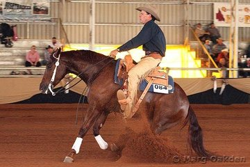 Warren Backhouse aboard Ray Gabbert's Red Chilli Peppa in the first go-round of the Open Futurity.