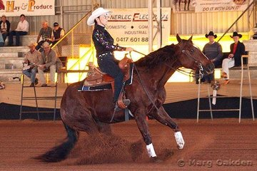 Elanora Flamez & Barbara Schleppi slide to a stop in the first go-round of the Non-Pro Derby at the Reining Australia Futurity & National Championship Show.