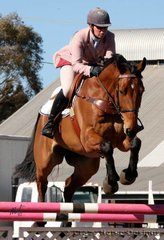 RSB Swift ridden by Rebecca Allen jump the Eagle Boys Pizza jump in the outdoor arena during the 1.10m Under 16 Points class