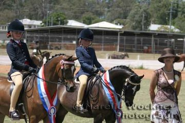 Champion Intermediate Small Pony Of The Year 'Mondiso Park Just A Dream' ridden by Brooke Langbecker and Reserve Champion 'Langtree Locksmith' ridden by Maddysen Sears with judge Joanne Prestwidge