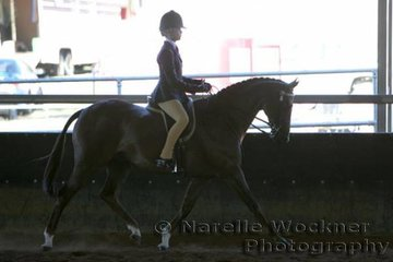 Hannah Evans working out to win Reserve Rider 12 Years & Under 15 Years