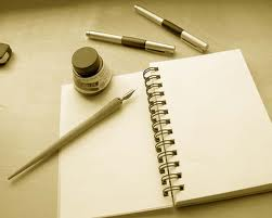 notebook and pens, writing our story, who we are