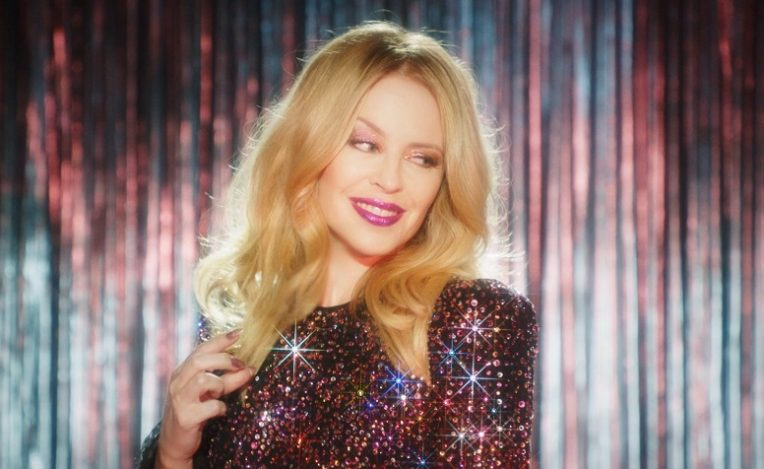 Kylie Minogue Tops Aus & UK Charts With New Album