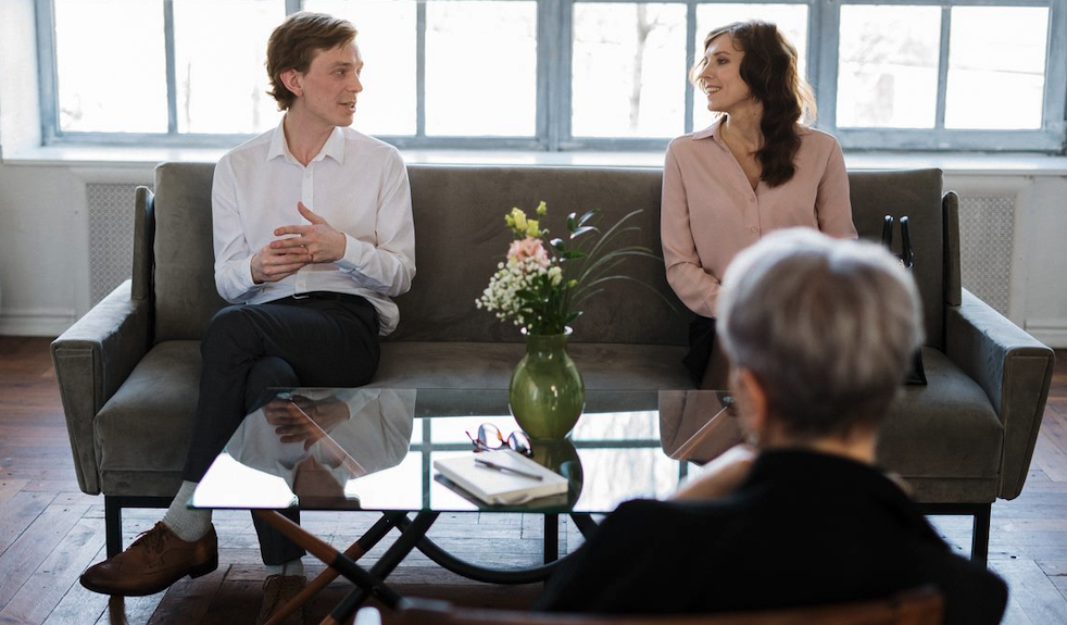 Husband and wife engaging in couples therapy