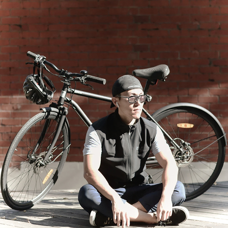Jerry wang doing the meditation pose near an iamfree bicycle