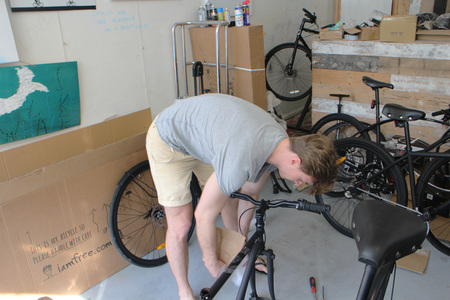 Henrik olander hjalmarsson working on a bicycle