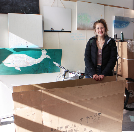 Bethany coley and her bicycle in a box