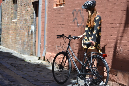 46 molly gibson looking at a bicycle