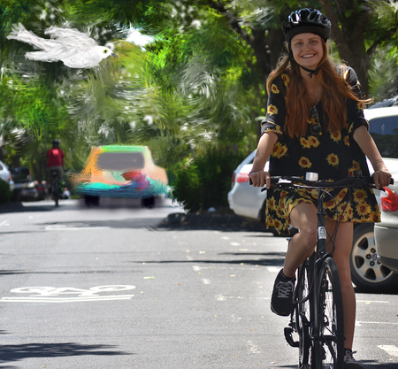 Molly gibson riding a bicycle on the road 2