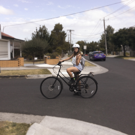 Breanna skewes with i am free bicycle near an intersection