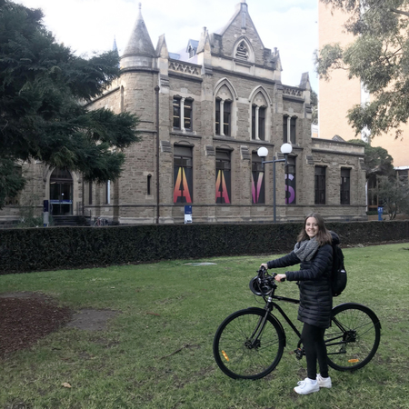 Sofia enrigue at melbourne university ground holding a bicycle