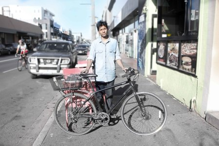 Anthony de silva with an i am free bicycle