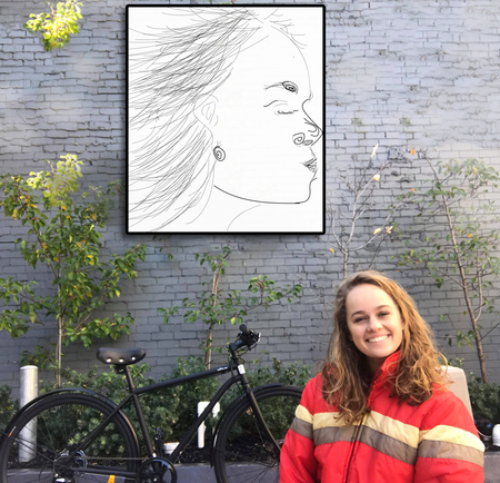 Breanna skewes near an artwork and bicycle