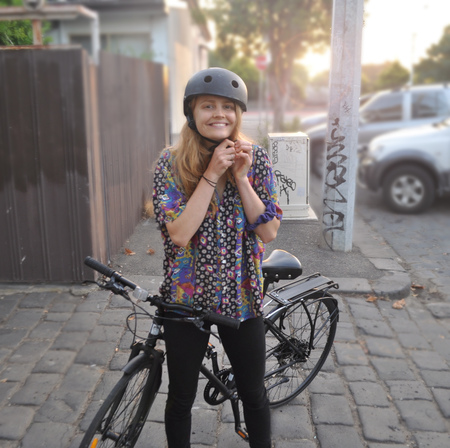 Molly gibson wearing a bicycle helmet
