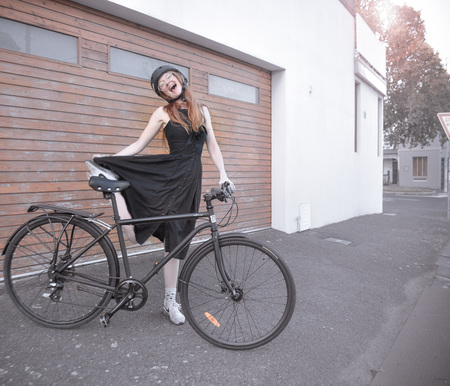 Freya doing an epic pose next an i am free bicycle