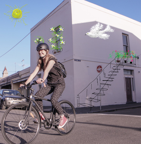 Molly gibson riding a bicycle in fitzroy