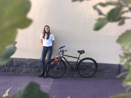 Lea wearne with a commuter bicycle