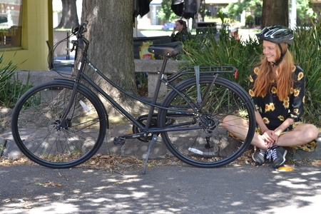 45 molly gibson next to matte black bicycle