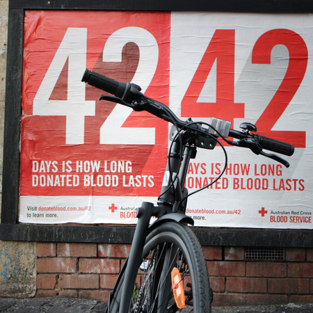 Blood donation posters and a bicycle
