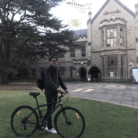 Ale alvarado at melbourne university ground holding a bicycle
