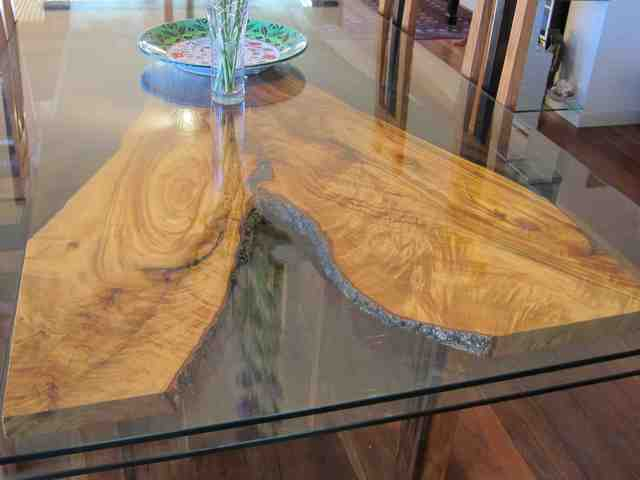 Dining table by Michael Zolotarev - New Guinea Rosewood, Camphor Laurel, Stainless Steel, Glass