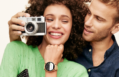 A man taking a photo with a woman wearing the Fossil Smartwatch