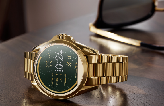 The gold Bradshaw watch on its side with watch face visible