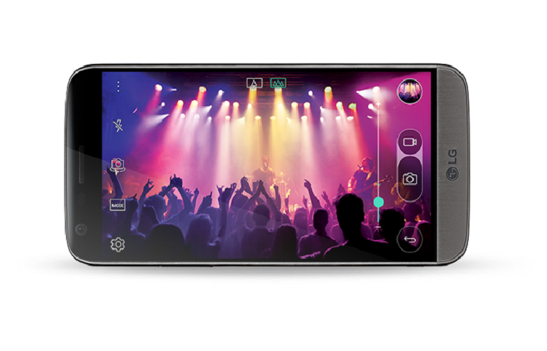 A concert video plays on the LG G5's wide screen in landscape mode