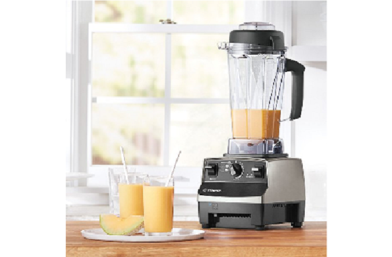 The Vitamix blender sitting on a kitchen bench with fresh fruit smoothies