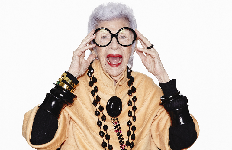 A close up of Iris Apfel wearing a Wisewear socialite activity tracker.