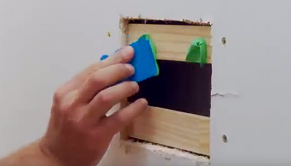 Apply adhesive to timber backing.