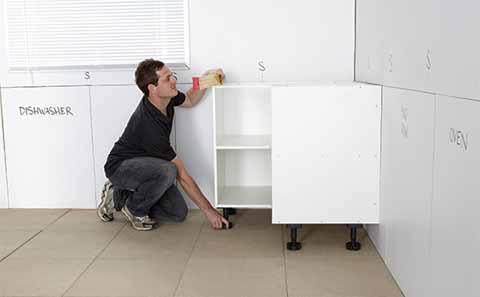 Install the corner kitchen cabinet first