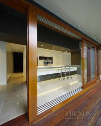 Two new kitchens in a modern extension to an old Queenslander.