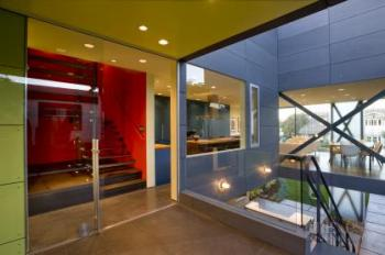 Heightened colors and open room connections make this house light-filled and welcoming