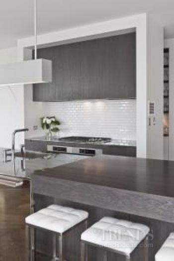 Minimalist, contemporary kitchen with stainless steel island by Morgan Cronin