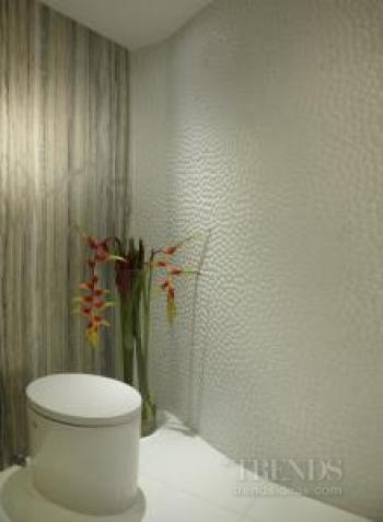 Textured pebble tile powder room by J Design