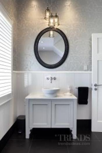 A pair of traditional bathrooms by Natalie Du Bois