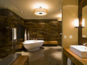 An exotic, glamorous master bathroom by David Wilkes