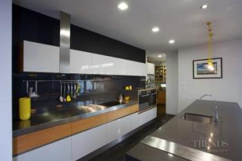 Sharp, contemporary kitchen with stainless steel