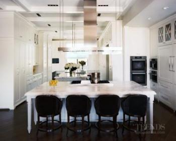 Traditional white kitchen with integrated appliances