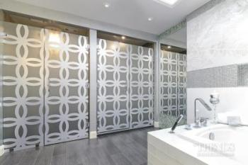 Tranquil bathroom with wood cabinetry and mosaic tile