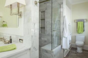 Transitional bathroom with marble subway tile and white vanity