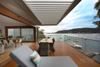 Multi-level, waterfront home with expansive decks. Image: 4