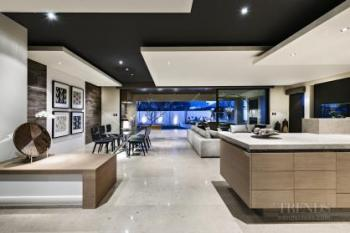 Kitchen connects with living spaces by shared palette and architectural lines