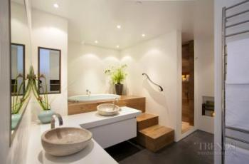 Bathroom with Japanese accent, porcelain tiles, Corian surfaces and soaking tub