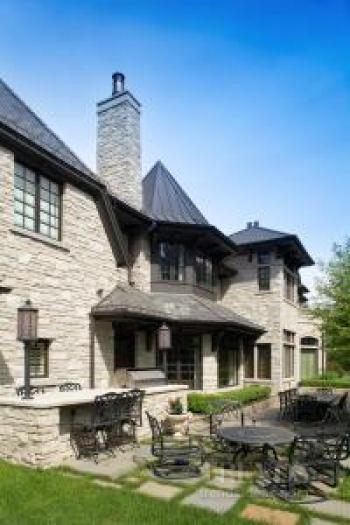 Stately traditional home made from solid stone with multi-gabled slate roof
