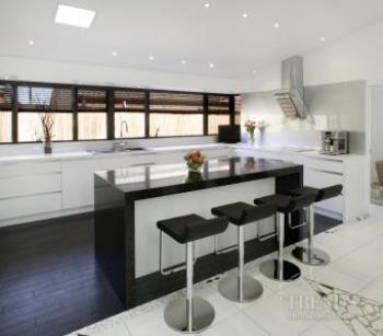 White Kitchen Black Benchtop and white contemporary kitchen with quartz benchtops, white glass